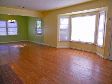 Alternate view of living room, with large picture window perfect for holiday decorations.