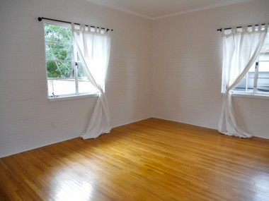 Back bedroom with ample closet space and more of those gorgeous hardwood floors!