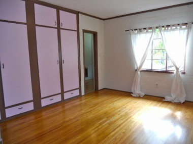 Spacious master bedroom suite (easily fits a king-size bed) with gorgeous floors, lots of closet space, and attached bathroom.
