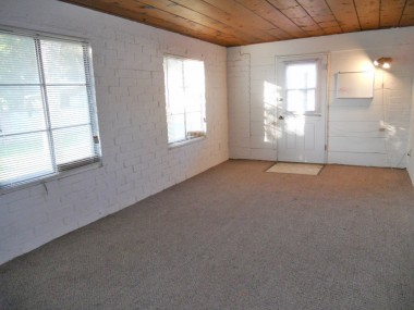 Guest room,. studio, or playroom.  Note the charming wood ceiling and ample windows which let in lots of light.