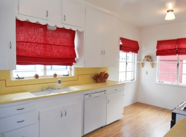 Bright and cheery kitchen with original counter tops and cabinetry in good condition.  Newer dishwasher and newer free-standing gas stove.