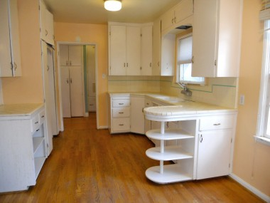 Original charming kitchen with lots of cabinetry and breakfast nook.