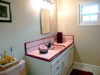 Hallway bathroom with original tile counters in fantastic condition, and a bathtub for those romantic bubble baths.