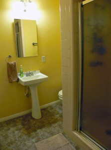 Master bathroom with newer pedestal sink and a shower stall.