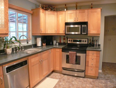 Breathtaking remodeled kitchen with corian counters, stainless steel appliances, etc.