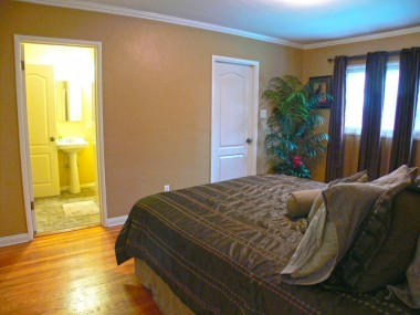Alternate view of master bedroom. Note the adjoining bathroom and exit door to backyard patio.
