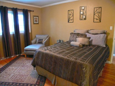 Master bedroom suite with crown molding, hardwood floors and adjoining private 3/4 bathroom.