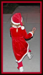 Aubyrnne skipping with joy after receiving a candy cane from Santa!