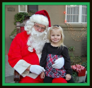 Brooklynn sitting on Santa's lap - 2010
