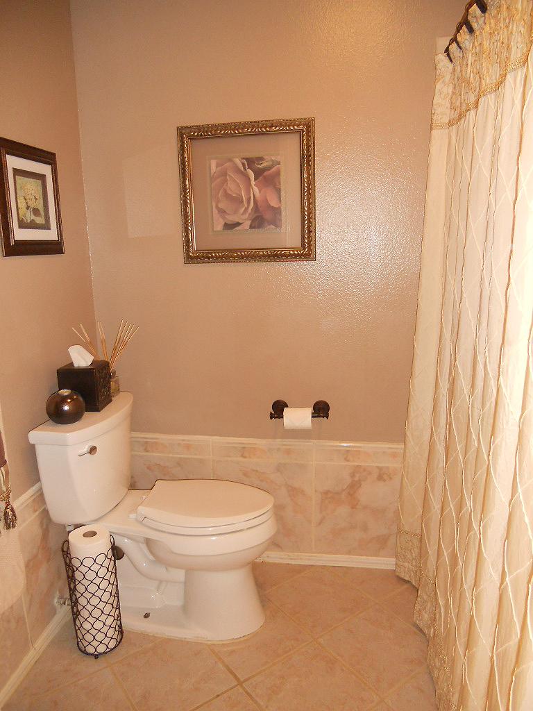 Elegantly remodeled hallway bathroom.