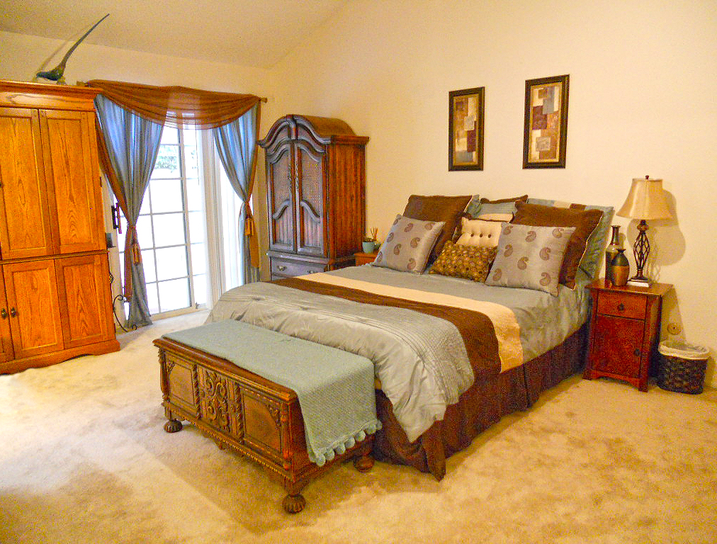 Huge master bedroom suite with vaulted ceiling.
