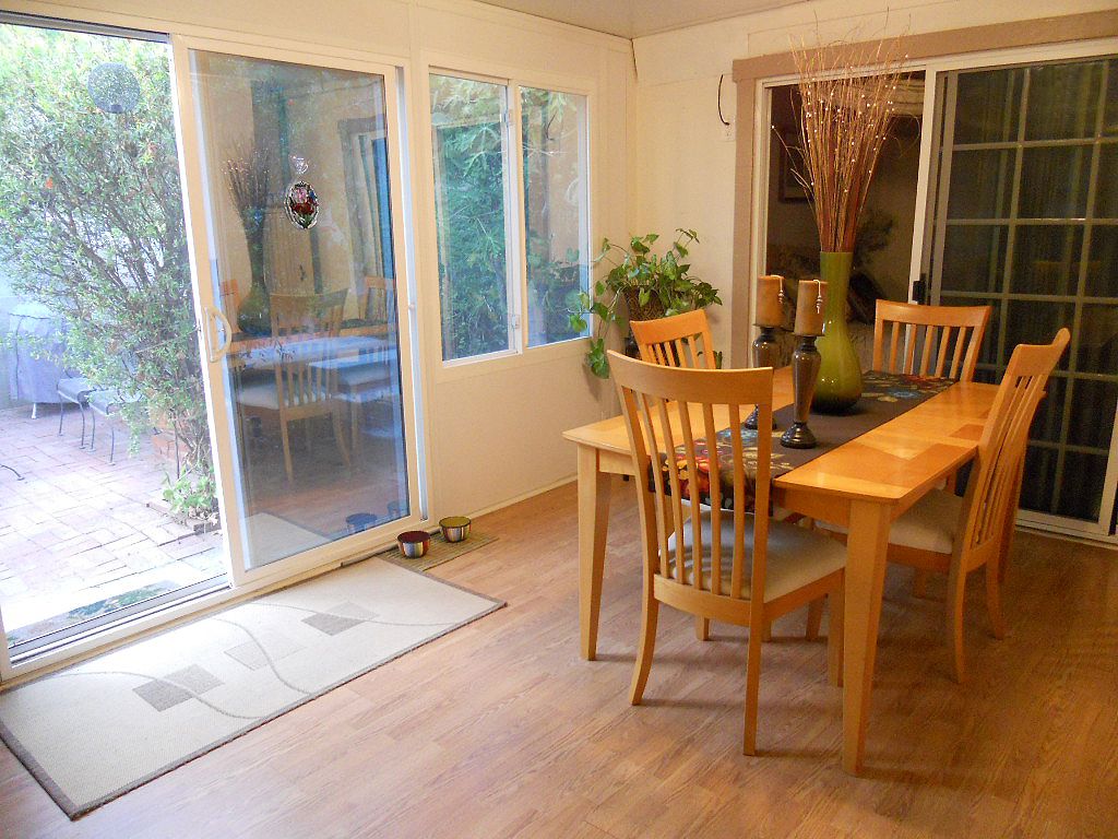 Bonus room with casual dining area overlooking charming back patio.