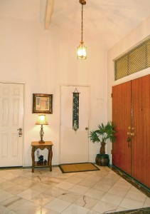 Double door entry leads to this bigger-than-life foyer with vaulted ceiling and stone floor!