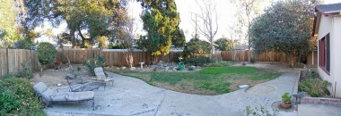 Panorama view of the huge backyard (lot size is over a quarter acre)! There is even a shed and more yard to the right, just out of photo view, beyond the living room. Don't forget to walk around there and check it out.