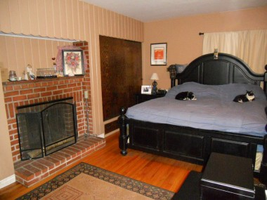 Large master bedroom easily accommodates a king-size bed.  Two sets of closets in this room, in addition to a romantic fireplace!