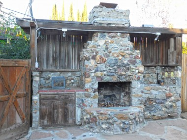 Fireplace and barbecue station -- look closely at all of the unique ceramic animals, hand prints, etc. built into this custom creation! Definitely one-of-a-kind!