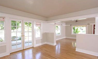 Formal dining room leading into front living room.