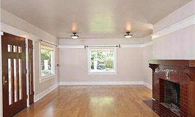 Huge living room with fireplace and hardwood floors and ORIGINAL 1920s front door!