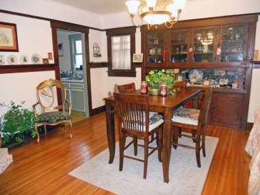 View of formal dining room upon entering the home. Note the plate rail which wraps around the whole dining room.