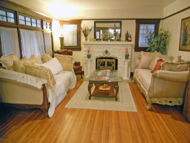Original hardwood floors, wood-burning fireplace, and wood-framed windows throughout the home.