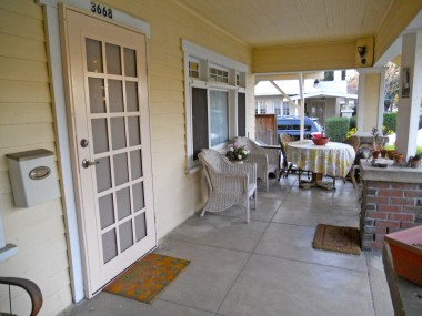 Spacious front porch -- wave your friends to come over and join you in a game of cards and a tall glass of lemonade on a cool summer's eve!