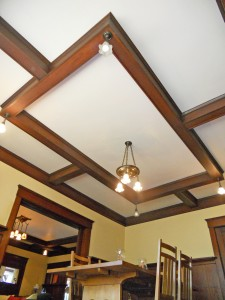 Intricate box beam ceilling in dining room with original light fixtures. Photo was taken from floor to expose as much of this amazing ceiling as possible.
