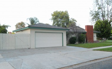 2-car garage with auto roll-up door, plus gated RV or boat parking.