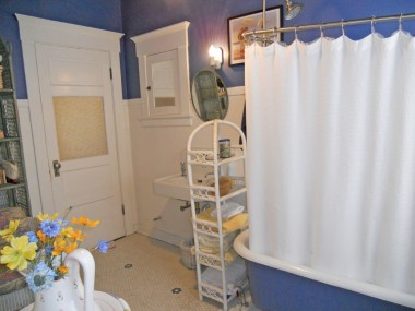 Upstairs bathroom with original sink, tile flooring, medicine chest, and claw foot tub!  There is also a separate tiled shower enclosure even though the claw foot tub has a circular shower curtain rod and stationary shower head.