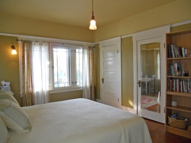 Alternate view of bedroom, with TWO closets and gorgeous original windows.