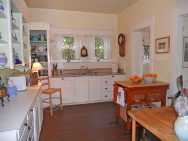 Spacious kitchen large enough for a preparation island, with original floors, new granite counter top, and built-in hutch. Breakfast nook far back right door.