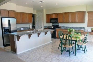 Gorgeous and enormous ktichen with granite counters, stainless steel frig which stays, dishwasher, and black stove. Built-in desk in the far right corner.