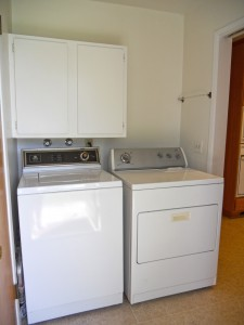 Separate indoor laundry room with cabinetry above machines and other side of room. Washer/dryer will go with house if buyer wants them.
