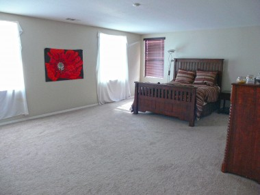 Enormous master bedroom suite. It's a blank canvas -- just think of the possibilities with all of your furniture!