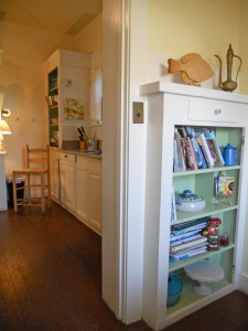 Built-in bookcase in the breakfast nook. Photo taken from nook bench and looking into the kitchen.