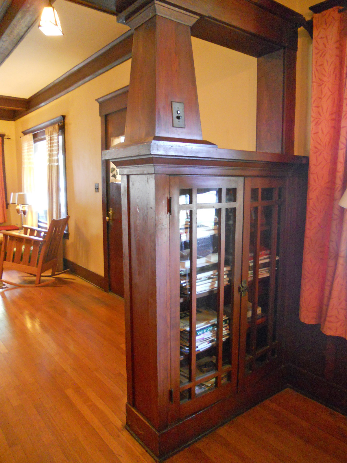 Craftsman columns with built-in bookcases separate the parlor from the living room (to the left).