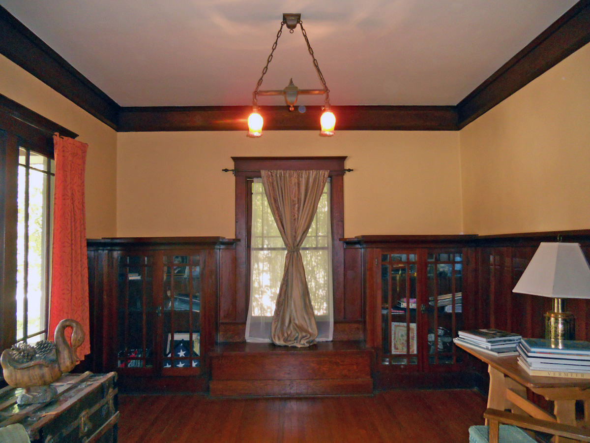 The parlor is to the left as you walk through the front door. Gorgeous original hardwood floors, crown molding and built-in shelving. A grand piano would fit perfectly in this room!