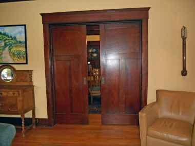 Original functioning pocket doors separating living room from formal dining room.