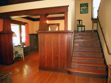 Parlor to the left, and to the right of the stairs is a short hallway that leads to the kitchen -- there is another stairway (originally for the servants) on the other side of the basement door access in same hallway.