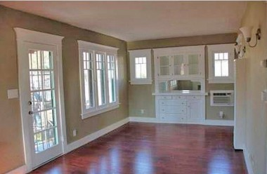 Dining area with original hutch, new floors, and original windows!