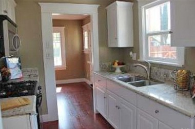 Completely remodeled kitchen with lots of cabinetry, granite counters, new appliances.