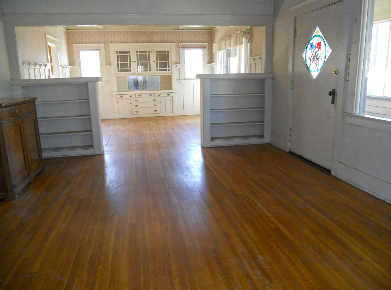 View from living room into the formal dining room, with the front door to the right.
