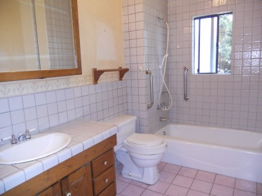 Updated bathroom with tile floor.