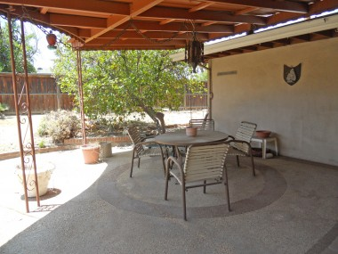 Covered patio perfect for year-round entertaining. Backyard has perfect side area for gardening and potting shed.