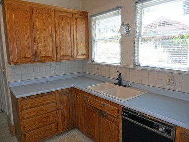 Updated kitchen with dishwasher, gas stove, built-in desk, and a walk-in pantry.