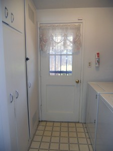 Separate indoor laundry room with lots of cabinetry and shelving. Washer and dryer are included with the sale.