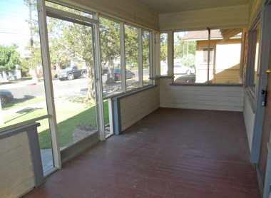 Alternate view of spacious screened-in front porch.