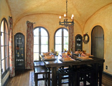 One of the most beautifully appointed formal dining rooms you'll ever see -- note the unique coved ceiling, built-in dinnerware niches, gorgeous arched windows, and an arched door leading to the kitchen.
