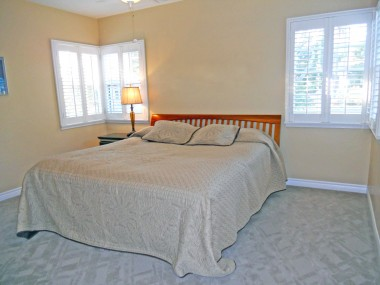 This is one of the large secondary bedrooms -- keep in mind this is a king-size bed!