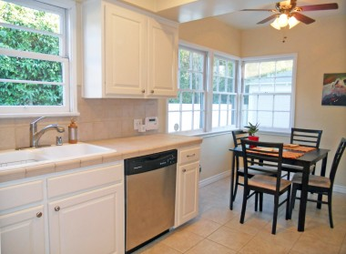 Alternate view of remodeled kitchen with dishwasher, and bright and charming breakfast nook.