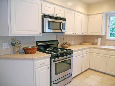 Remodeled kitchen with built-in microwave and gas stove (refrigerator stays too).